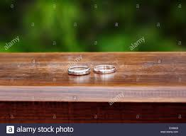 Wedding Engagement Rings Close Up On Wood Background Rustic Style Decoration