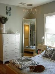 Large Mirror In Corner Of Bedroom With Chandelier Above It I Love This Dresser