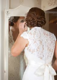 Bride Getting Ready In Her Suite With Knotty Updo