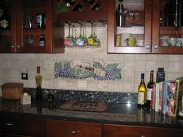 Mural Backsplash And Three Bottles Plus White Vase Under Glass Door Kitchen Cabinet
