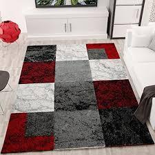 wohnzimmer teppich modern schwarz rot grau marmor stein
