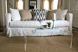 Crate And Barrel Verano Sofa Slipcover by White Slipcovered Sofa Natural Fiber Rug Lucite Coffee Table