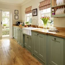 Sage Green Kitchen Cabinets With White Appliances by Sage Green Lower Cabinets Leave Uppers In Honey Stained Knotty