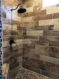 wood look tile shower with pebble floor bathroom tiles and