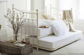 White Laura Ashley Bedding Plus Pillows With Cream Headboard Matched Wall For Bedroom Decor