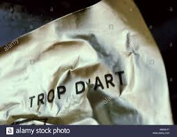 Too Much Art Text In French On Printed On Crumpled Paper Stock Photo