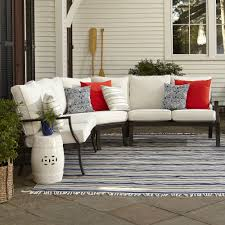 exterior dark sectional wicker sofa with white sunbrella
