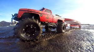 100 Big Trucks Mudding Videos RC ADVENTURES Mega Mud Truck Blows Motor Pulling Speed Boat