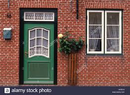 Green Door in Red Brick House Stock Royalty Free Image