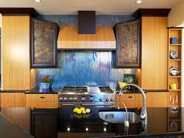 contemporary kitchen with glossy blue counter backsplash using
