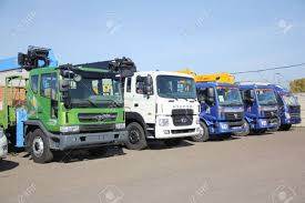White, Blue, Green Flatbed Trucks With Yellow Crane Arm Is In ... Various Old Articuated Tractor And Flatbed Trucks At Smallwood Stock 1995 Mack Rd690s W 206 Steel Flatbed Trailer 2017 Intertional 4300 Truck For Sale 752 Miles Used Trucks For Sale Loading Saferack Man Stands On Roadside Editorial Photography Image Truck Wikipedia Tommy Gate Liftgates For Flatbeds Box What To Know 2011 Intertional 4400 Truck In New Jersey Isuzu 10665 Economy Mfg