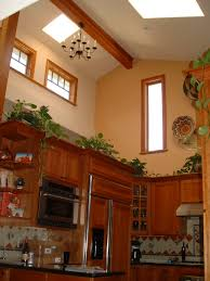 Above Kitchen Cabinet Decorations Pictures by Decorating Above Kitchen Cabinets With Vaulted Ceilin
