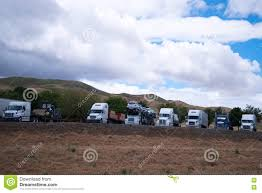 Semi Trucks Stop In Row On California Rest Area Stock Photo - Image ...