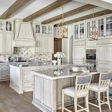 white distressed kitchen with marble arabesque tiles