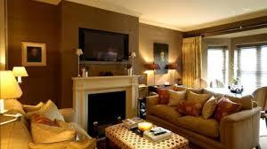 Earth Tones Living Room Design Ideas by Earth Tones Paint Beige Rattan Window Blinds Beige Hanging Lamps