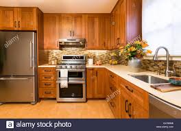 Contemporary Upscale Home Kitchen Interior With Cherry Wood Cabinets Quartz Countertops Sustainable Recycled Linoleum Floors