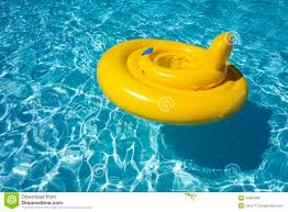 Inflatable Tubes For Toddlers by Child Swimming On Yellow Inflatable Tube In Pool Stock Photo