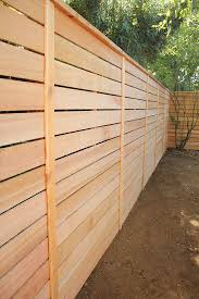 building with western red cedar cascade fence deck