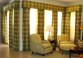 Living Room Curtains Ideas 2015 by Two Windows Using Dark Brown Curved Ruffle Valance Combined With
