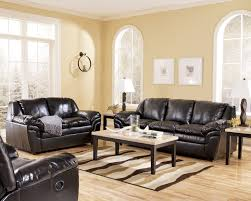 black leather sofa and rectangle black wooden table with white top