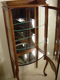 Curved Glass Curio Cabinet by Petite Oak Curved Glass Curio Cabinet