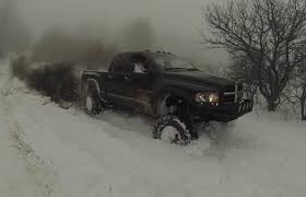 100 Trucks In Snow This Mean Lifted Cummins Battles The Like A Real Boss