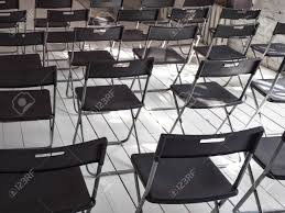 Black Folding Chairs Stand In Rows In The White Conference Room ... Chair With Tablemeeting Room Mesh Folding Wheels Scale 11 Nomad 12 Conference Table Wayfair Row Of Chairs In The Stock Photo Image Of Carl Hansen Sn Mk99200 By Mogens Koch 1932 Body Builder 18w X 60l 5 Ft Seminar Traing Plastic Tables Centre Office Cc0 Classroomoffice Chairs Lined Up In Empty Conference Room Slimstacking And Lking For Meeting Ton Rows Red Picture Pp Mesh Back Massage Folding Traing Chair Padded