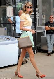 Strides Ahead On Tuesday Taylor Donned A Doll Like 50s Style Outfit Finishing The