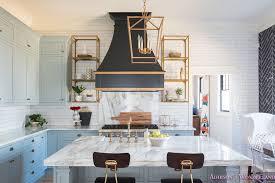 kitchen white marble calcutta gold open shelves gold black vent