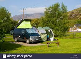A Small Campervan With Side Awning On A Camp Site At Adrigole ... Outdoor Revolution Movelite Pro Carbon Midi Drive Away Motorhome Sunncamp Rotonde 350 Inflatable Air Frame Awning Awnings Caravan Window Blinds Chenille Door Parts Accsories For Your Motorhome Inserting In Side A Mazda Bongo Campervan With Side Awning On A Camp Site Near With Sides Alinum Under Decking Custom Built Amazoncom Rv Shade Trailer Universal Motordome Khyam Driveaway Classic Uk Camping From Wind Out Thule Give You Rodeo Sprint Campervan Annexe Drive Away
