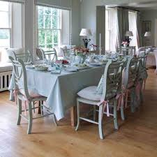 Feminine Kitchen Chair Cushions In Pink Colored Ribbon Tie Backs On White Tone Dining Room