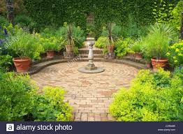 Paved Brick Garden Path Leading To Sundial In Circular Paved Area ... Garden Eaging Picture Of Small Backyard Landscaping Decoration Best Elegant Front Path Ideas Uk Spectacular Designs River 25 Flagstone Path Ideas On Pinterest Lkway Define Pathyways Yard Landscape Design Ma Makeover Bbcoms House Design Housedesign Stone Outdoor Fniture Modern Diy On A Budget For How To Illuminate Your With Lighting Hgtv Garden Pea Gravel Decorative Rocks