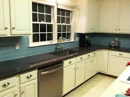 white glass subway tile backsplash with wooden kitchen cabinets
