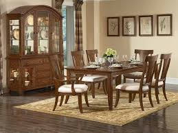 Interesting Wooden Dining Set In Brown By Kathy Ireland Furniture And Cabinet On Floor