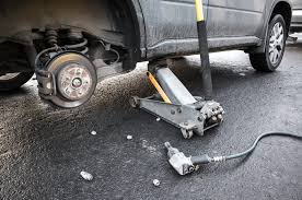 Trolley Jack Vs Floor Jack by All About Car Jacks And Stands Yourmechanic Advice