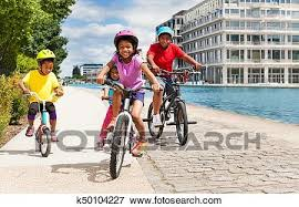 Picture Of Cute African Girl Riding Bicycle With Her Friends