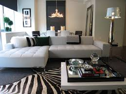 Black Leather Sofa Decorating Ideas by L Shaped White Leather Couch With Black Cushions Combined By White