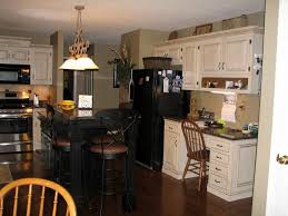 Off White Kitchen Cabinets With Black Appliances Image
