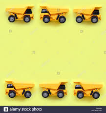 100 Trucks Paper Many Small Yellow Toy Trucks On Texture Background Of Fashion Pastel