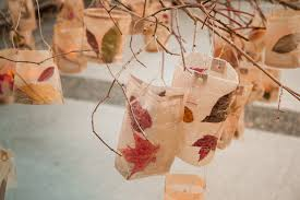 Lanterns Hanging From The Chandelier Branches Made Wax Paper Pressed Leaves And Cardboard