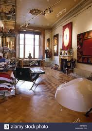 sitting room with barcelona chair and parquet floor stock