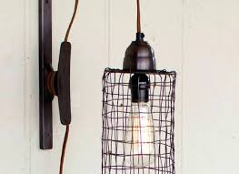 edison wall sconce industrial modern cage and pulley in wall