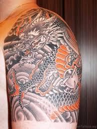 Fancy Asian Dragon Tattoo On Shoulder