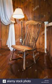 Antique Wooden Rocking Chair And Lamp, Inside A New Hampton ... Angloindian Teakwood Rocking Chair The Past Perfect Big Sf3107 Buy Bent Wood Chairantique Chairwooden Product On Alibacom Antique Painted Doll Childs Great Paint Loss Bisini Luxury Ivory And White Color Wooden Handmade Carved Adult Prices Bf0710122 Classic Stock Illustration Chairs Fniture Table Png 2597x3662px Indoor Solid For Isolated Image Of Seat Replacement And Finish Facebook Wooden Rocking Chair Isolated White Background