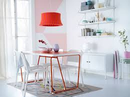 Ikea Dining Room Furniture by A Dining Room With A Orange Dining Table And White Chairs