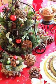 A Cupcake Stand With Evergreens Pinecones And Vine Balls