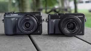 The Panasonic Lumix GX7 Left And LX100 Side By They Offer Same Sized Four Thirds Sensors But LX100s Lens Is Fixed Where GX7s