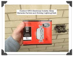 outdoor light with gfci outlet iron
