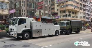 PLA Truck Towed By Japanese-branded Wrecker