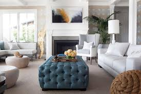 Two Tone Wingback Chair with Blue Tufted Ottoman as Coffee Table